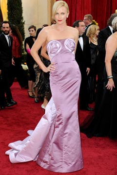 charlize theron dior haute couture lilac gown boobs rosettes Oscars 2010