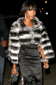 naomi campbell black and white fur coat skirt