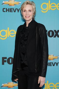 Jane Lynch engagement ring black ruffle shirt