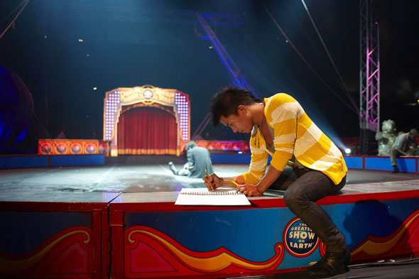Jay Nicolas Sario sketching circus tent project runway