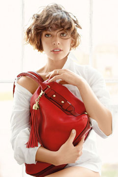 Milla Jovovich 2010 Tommy Hilfiger for Breast Health International campaign red handbag