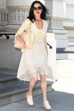 catherine zeta-jones cream dress cream overcoat chanel quilted bag clogs