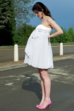 pregnant woman pink high heels white dress