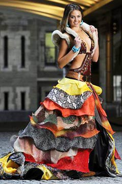 Miss Australia Jesinta Campbell Uggs sheepskin rug shrug cut-out one-piece swimsuit multicolored flamenco-style skirt