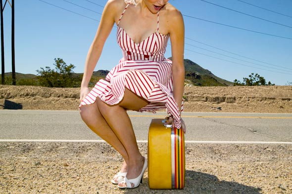 woman-with-suitcase-on-side-of-road-590bes073010.jpg
