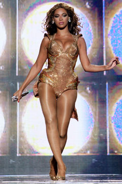 Beyonce gold bodysuit performing stage hosiery shimmery