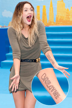 drew barrymore breathe tattoo arm going the distance london premiere olive green alexander mcqueen dress black balmain belt