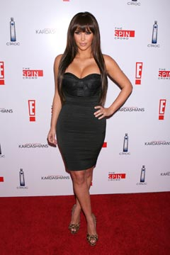 kim kardashian bangs black strapless bustier dress leopard peep-toe platform heels