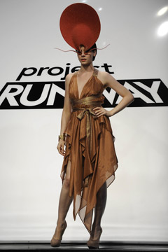 project runway michael costello red phillip treacy hat model bronze wrap dress