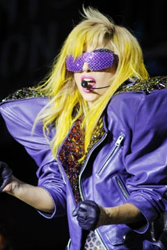 lady gaga yellow hear purple leather jacket purple glasses gloves