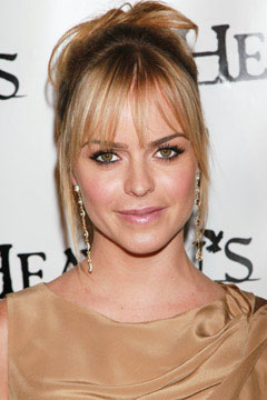 Taryn Manning headshot tan dress bangs
