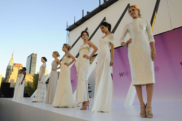 WIE white gowns auctioned off support White Ribbon Alliance WIE symposium