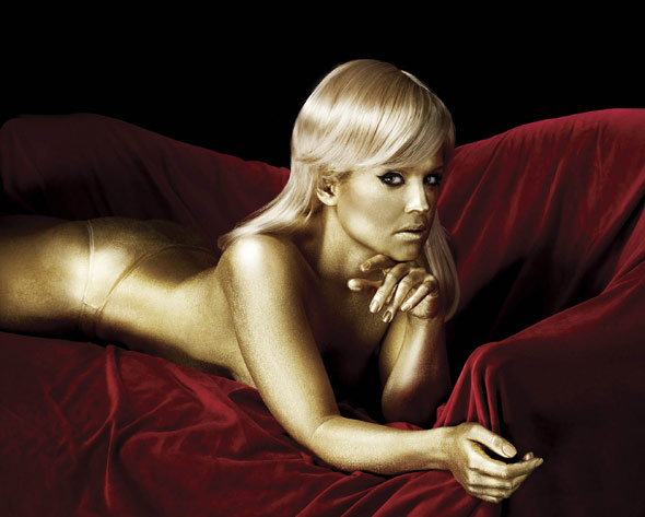Kelly Osbourne topless gold body paint Goldfinger style shoot
