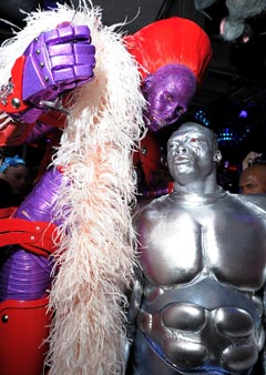 heidi klum halloween party 2010 purple red superhero armor seal silve surfer abs muscles boa