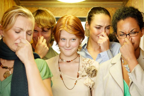 women holding noses elevator smell body odor