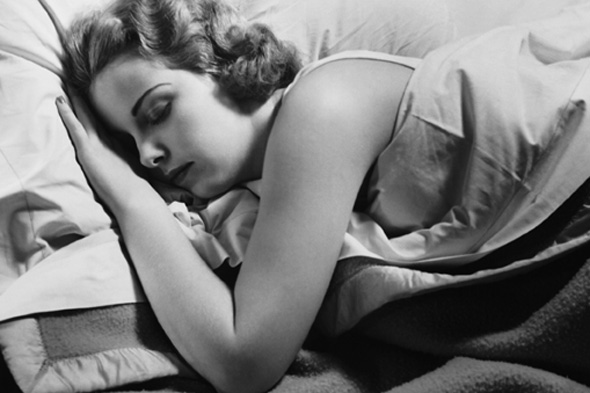 Black and white photo of a white woman sleeping