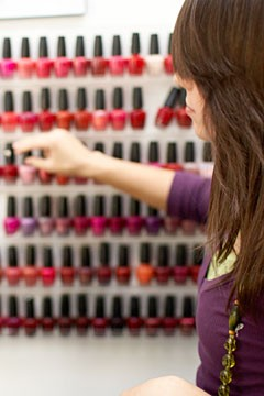 woman choosing nail polish