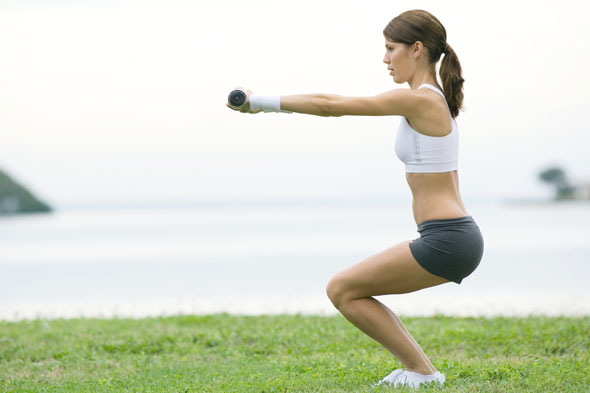 woman doing lunges with weight