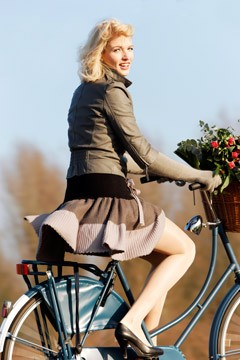 woman riding bicycle in miniskirt high heels