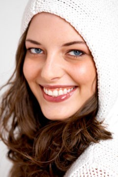 woman curly hair wearing hoodie