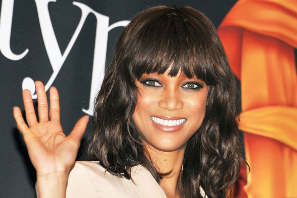 Tyra Banks blunt bangs at New York Stock Exchange