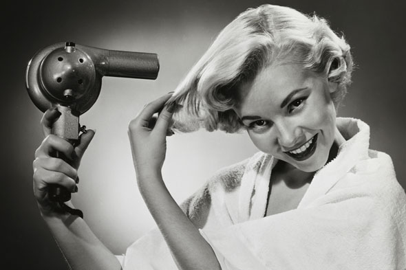 woman blow-drying hair