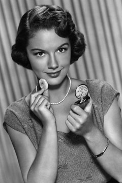 Vintage image of woman applying face powder