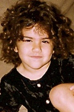 Associate editor Sarah St. Lifer as a child with Shirley Temple curls