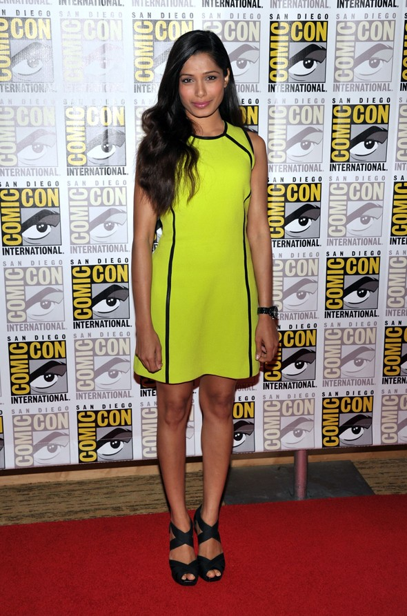 Freida Pinto neon yellow michael kors comic con black sandals