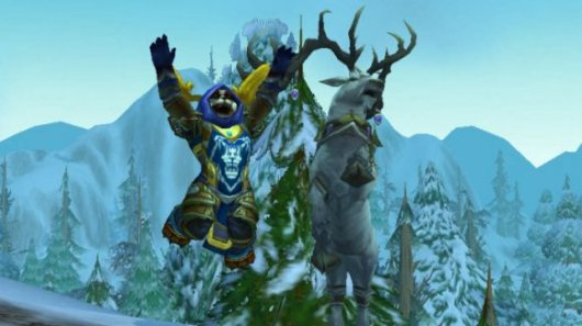 Thanks to WoW Insider for this epic screenshot of a pandaren and a reindeer jumping for joy. Epic.