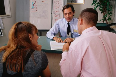 people in a meeting with adviser