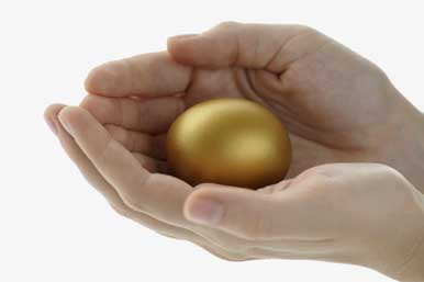 Golden egg in hand