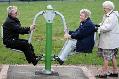 Elderly people on a seesaw
