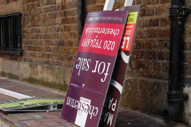 broken 'for sale' sign