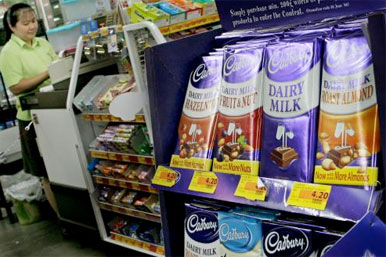 chcolate on shelves near a checkout