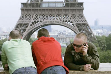 man phoning by Eiffel Tower, Paris