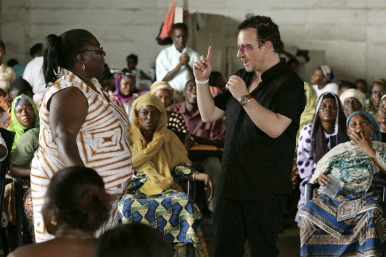 Women in Ghana with Bono discussing microfinance