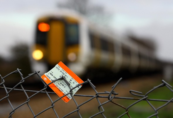 Train ticket with train in background