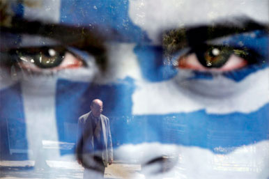 man in reflection of Greek poster of face paonted blue and white