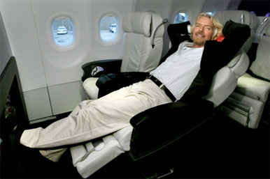 Richard Branson in first class virgin ariline seat