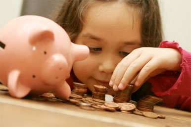child with piggy bank