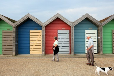 older people with beach huts