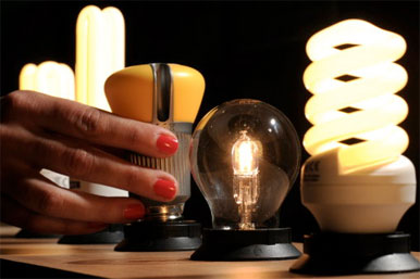 old and modern energy effiecient light bulbs
