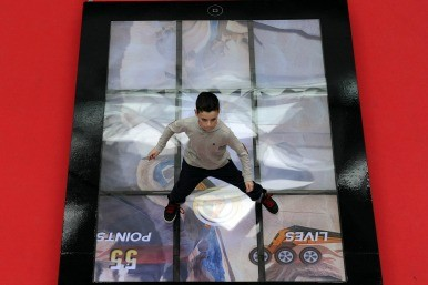 boy on giant ipad