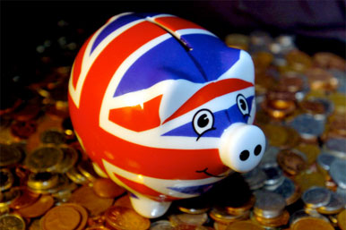 union jack piggy bank and coins