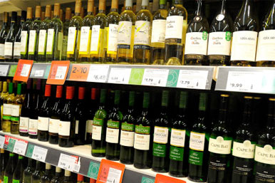 bottles of wine on a supermarket shelf