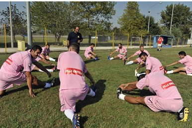 Voukefalas football team training in pink jerseys