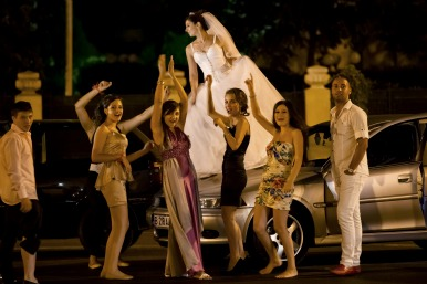 Bride dances on her car