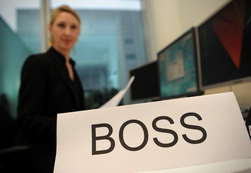 Woman with boss sign in front of her