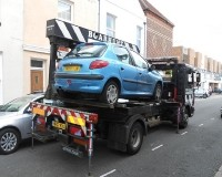 Car being towed away in Portsmouth